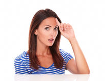 Surprised young lady pointing to her forehead Royalty Free Stock Images