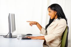 Surprised young lady at work Stock Image