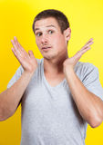 Surprised young man Stock Images