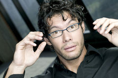 Surprised young man. With glasses looking at the camera Royalty Free Stock Images