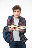 Surprised young man with books Royalty Free Stock Images