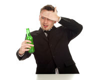 Surprised young man with bottle of beer Royalty Free Stock Image