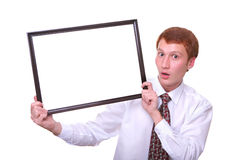 Surprised young man holding a frame Stock Image