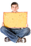 Surprised young man holding yellow board Royalty Free Stock Image