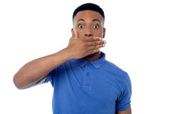 Surprised young man looking at camera Royalty Free Stock Photography