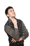 Surprised young man looking and pointing up Stock Photo