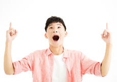 Surprised young man looking up Stock Photos