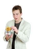 Surprised young man opening gift box Stock Photos