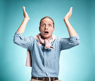 The surprised young man over blue background Royalty Free Stock Image