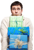 Surprised young man with presents Stock Photography