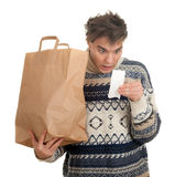 Surprised young man with store receipt Royalty Free Stock Photo