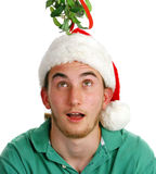 Surprised Young Man Under Mistletoe royalty free stock images