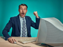 Surprised Young Man Working On computer At Desk Royalty Free Stock Photo