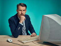 Surprised Young Man Working On computer At Desk Royalty Free Stock Image