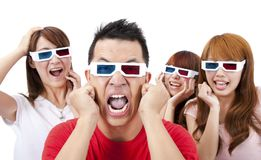 Surprised Young people in 3D glasses Royalty Free Stock Photos