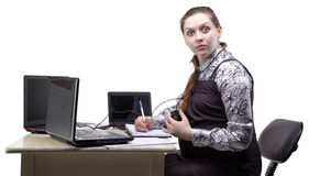 Surprised young pregnant woman at work stock photography