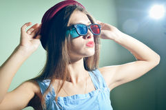Surprised young pretty woman in 3d glasses looking amazed. Royalty Free Stock Images