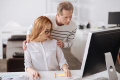 Surprised young secretary collaborating with boss at work Royalty Free Stock Photos