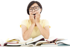 Surprised young student girl with many book. Over white background Stock Photos