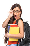 Surprised young student holding glasses. Royalty Free Stock Images
