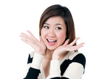 Surprised Young Woman. Portrait of an attractive young Asian woman looking surprised over white background Stock Images