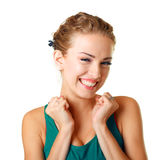 Surprised young woman. Portrait of a surprised young woman with hands over her mouth laughing against white background Royalty Free Stock Photo