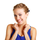 Surprised young woman. Portrait of a surprised young woman with hands over her mouth laughing against white background Stock Photo