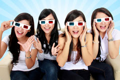 Surprised Young woman in 3D glasses. Surprised Young women in 3D glasses and watching a movie Stock Photo