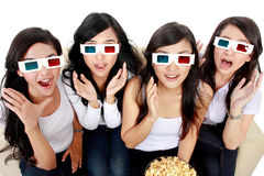 Surprised Young woman in 3D glasses Stock Photo
