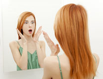 Surprised young woman in bathroom Stock Photography