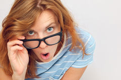 Surprised young woman. Beautiful young woman with black glasses surprised Stock Photography