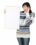 Surprised young woman with blank poster Stock Photography