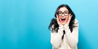 Surprised young woman on a bright background royalty free stock photo