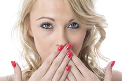 Surprised Young Woman Covering Mouth with Hands Royalty Free Stock Photos