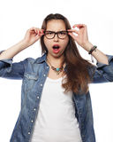 Surprised young woman in glasses over white background. Surprised young brunette woman in glasses over white background Stock Photo