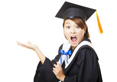 Surprised young woman graduating holding diploma Stock Photography