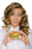 Surprised young woman with hamburger Stock Image