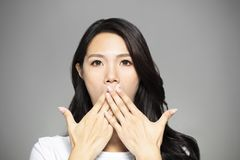 Surprised young woman hands coverd the mouth royalty free stock photography