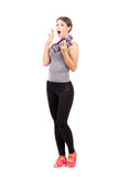 Surprised young woman holding aerobic foam dumb-bells Royalty Free Stock Photo