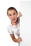 Surprised young woman holding board Stock Photography
