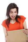 Surprised young woman holding a cardboard box Royalty Free Stock Image