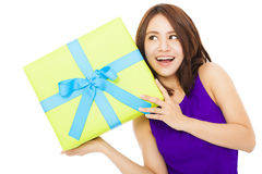 Surprised young woman holding a gift box Stock Images
