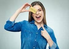 Surprised young woman holding golden credit card. Isolated portrait Stock Photography