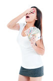 Surprised Young Woman Holding Money Stock Photography