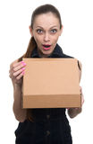Surprised young woman holding a parcel Stock Photography