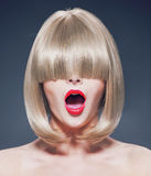 Surprised young woman with a long fringe Stock Photos
