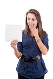 Surprised young woman looking at a blank card Stock Images