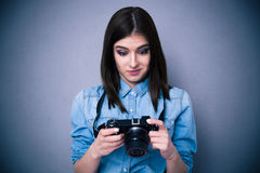Surprised young woman looking on camera screen Royalty Free Stock Image