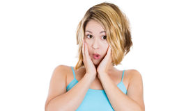 Surprised young woman looking surprised, shocked and puzzled Stock Images