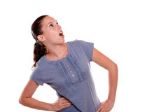 Surprised young woman looking to her left up Stock Photography
